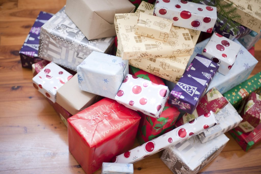 Holiday Gift Guide Pile of gift-wrapped Christmas presents